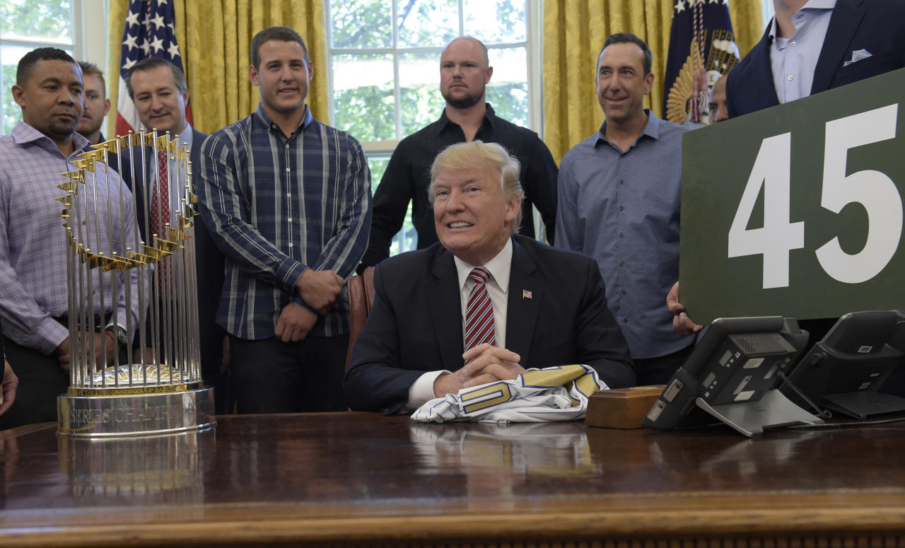 President Donald Trump pauses as he is asked a question on health care as he meets with members of the 2016 World Series Champions Chicago Cubs, Wednesday, June 28, 2017, in the Oval Office of the White House in Washington. (AP Photo/Susan Walsh)