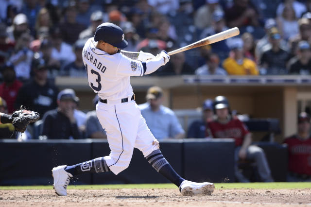 San Diego Padres' Manny Machado hits a two-run home run during the seventh inning of a baseball game against the Arizona Diamondbacks Wednesday, April 3, 2019, in San Diego. (AP Photo/Orlando Ramirez)