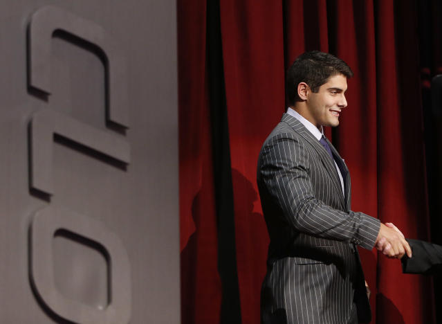 Eastern Illinois quarterback Jimmy Garoppolo is congratulated after being selected as the 62nd pick by the New England Patriots in the second round of the 2014 NFL Draft, Friday, May 9, 2014, in New York. (AP Photo/Jason DeCrow)