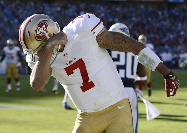San Francisco 49ers quarterback Colin Kaepernick (7) celebrates after scoring a touchdown against the Tennessee Titans on a 20-yard run in the second quarter of an NFL football game on Sunday, Oct. 20, 2013, in Nashville, Tenn. (AP Photo/Mark Zaleski)