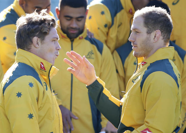Australia's Michael Hooper, left, and David Pocock chat each other before their captain's run training session in Sydney, Friday, June 22, 2018, ahead of their rugby union test match against Ireland. Australia will play Ireland in Sydney on Saturday. (AP Photo/Rick Rycroft)