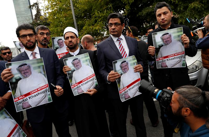Human rights activists and friends of Saudi journalist Jamal Khashoggi hold his pictures during a protest outside the Saudi Consulate in Istanbul. (Murad Sezer / Reuters)