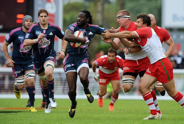 Stade Français' winger Paul Sackey (C) breaks away from Biarritz's flanker Imanol Harinordoquy (2ndR) and full-back Marcelo Bosch (R) during the French Top 14 rugby union match Biarritz vs Stade Français at the Aguilera stadium in Biarritz, southern France, on May 12, 2012. AFP PHOTO / GAIZKA IROZGAIZKA IROZ/AFP/GettyImages