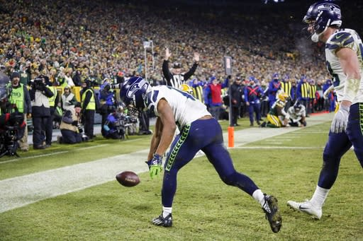 Seattle Seahawks' Tyler Lockett celebrates his touchdown catch during the second half of an NFL divisional playoff football game against the Green Bay Packers Sunday, Jan. 12, 2020, in Green Bay, Wis. (AP Photo/Matt Ludtke)