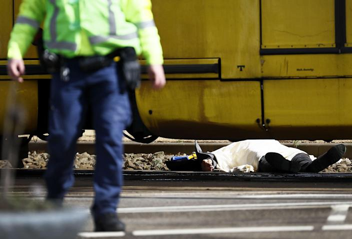 A body lying on the ground is covered near a tram at the 24 Oktoberplace in Utrecht, on March 18, 2019 where a shooting took place. (Photo: Robin Van Lonkhuijsen/AFP/Getty Images)