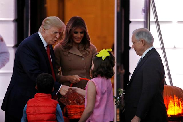 <p>U.S. Attorney General Jeff Sessions (R) accompanies children while U.S. President Donald Trump reacts as he and First Lady Melania Trump give out Halloween treats to children from the South Portico of the Washington, D.C. on Oct. 30, 2017. (Photo: Carlos Barria/Reuters) </p>