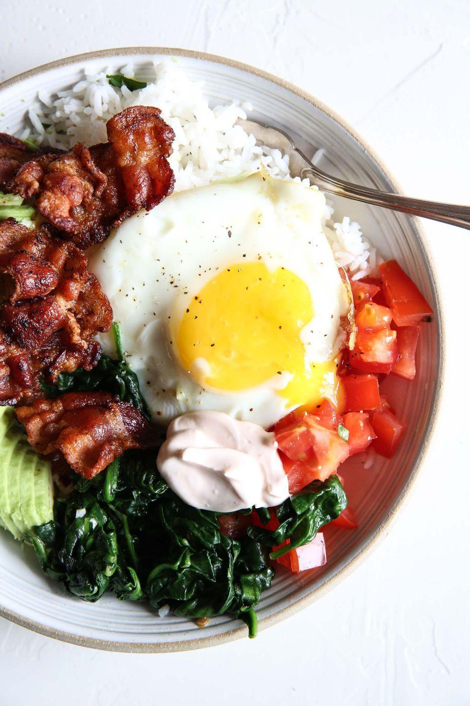 """<p>BLTs are breaking out from bread.</p><p>Get the recipe from <a href=""""https://www.delish.com/cooking/recipe-ideas/recipes/a51789/blt-rice-bowl-recipe/"""" rel=""""nofollow noopener"""" target=""""_blank"""" data-ylk=""""slk:Delish"""" class=""""link rapid-noclick-resp"""">Delish</a>. </p>"""