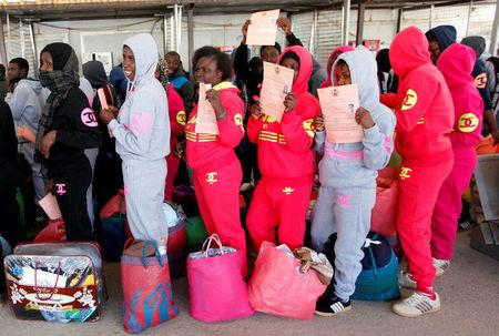 FILE PHOTO: Illegal African migrants arrive at Mitiga International Airport before their voluntary return to their countries, east of Tripoli