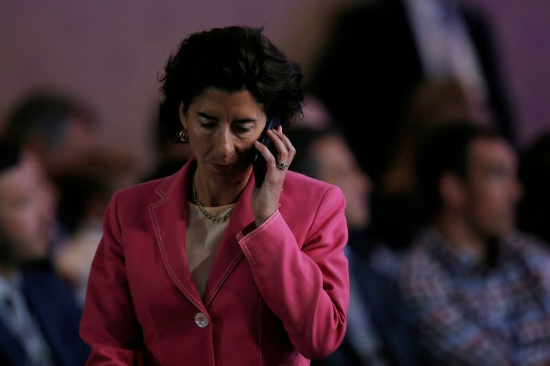 Rhode Island Governor Gina Raimondo answers a phone call during the National Governors Association Summer Meeting in Providence