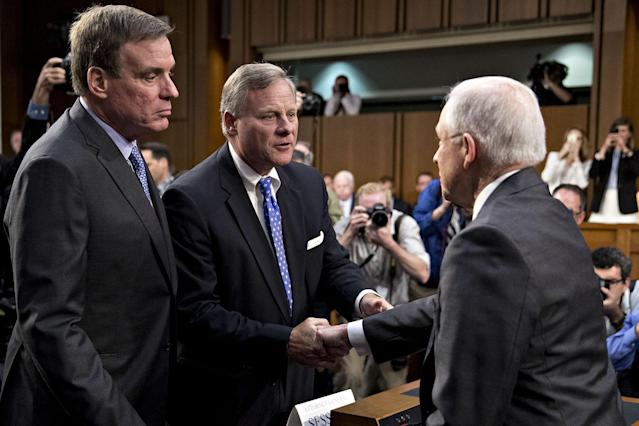 <p>Jeff Sessions, U.S. attorney general, right, shakes hands with Senator Richard Burr, a Republican from North Carolina and chairman of the Senate Intelligence Committee, next to ranking member Senator Mark Warner, a Democrat from Virginia, left, before a hearing in Washington, D.C., on Tuesday, June 13, 2017. (Andrew Harrer/Bloomberg via Getty Images) </p>