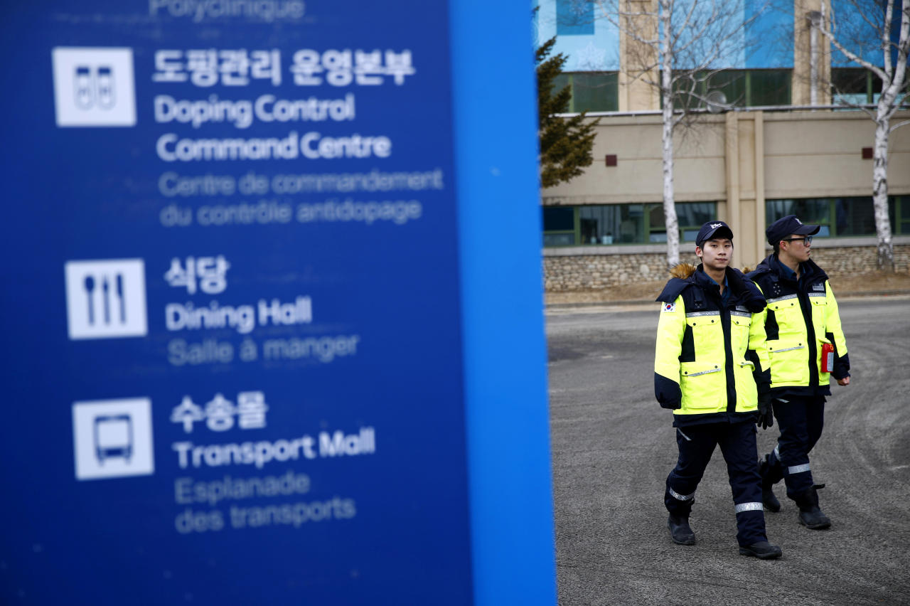 <p>Police officers patrol inside the PyeongChang Olympic Village prior to the 2018 Winter Olympics in PyeongChang, South Korea. (Patrick Semansky/AP) </p>