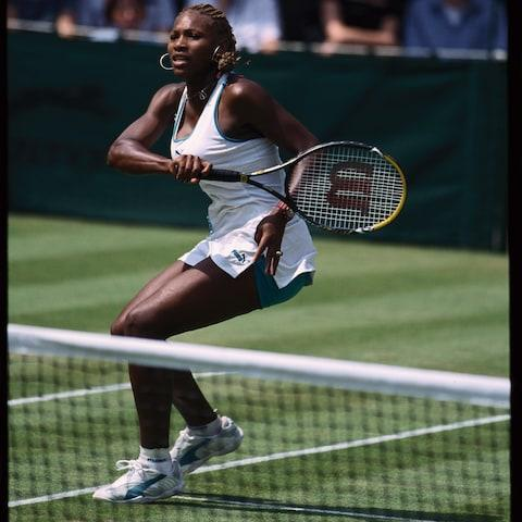 Serena Williams at Wimbledon in 1997. She is the most successful woman player on grass - Credit: Getty