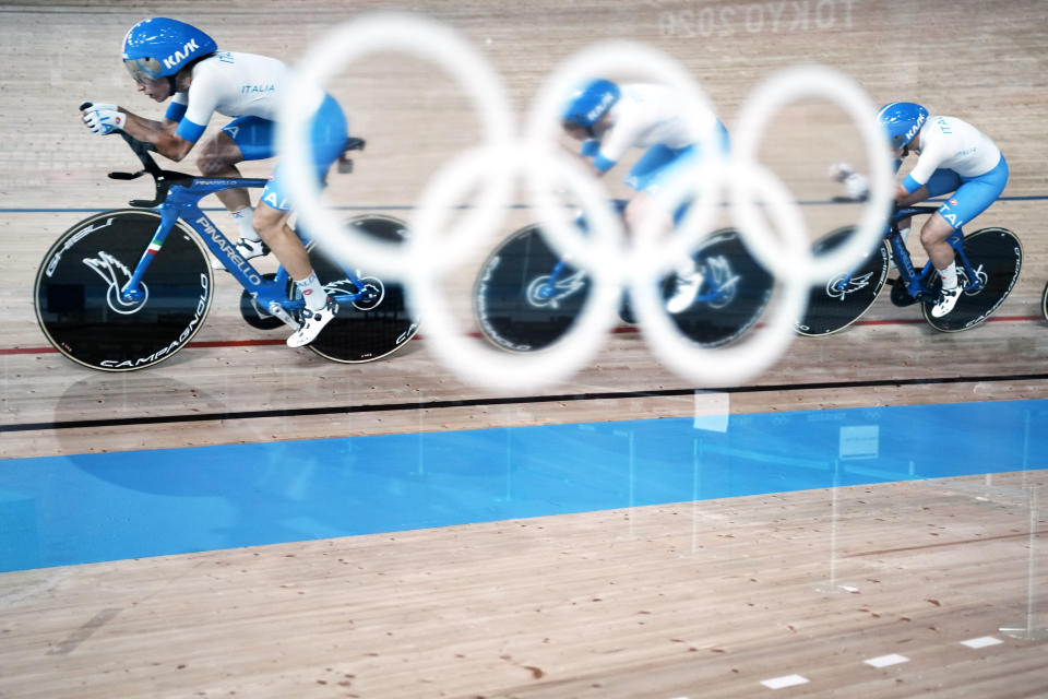 Members of the Italian women's track cycling team round the track during a training session inside the Izu velodrome at the 2020 Summer Olympics, Thursday, July 29, 2021, in Tokyo, Japan. (AP Photo/Thibault Camus)