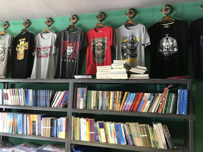 "A shop near Hohhot's university district sells T-shirts with popular Mongolian symbols and band names, and Mongolian-language books. <span class=""copyright"">(Alice Su / Los Angeles Times)</span>"