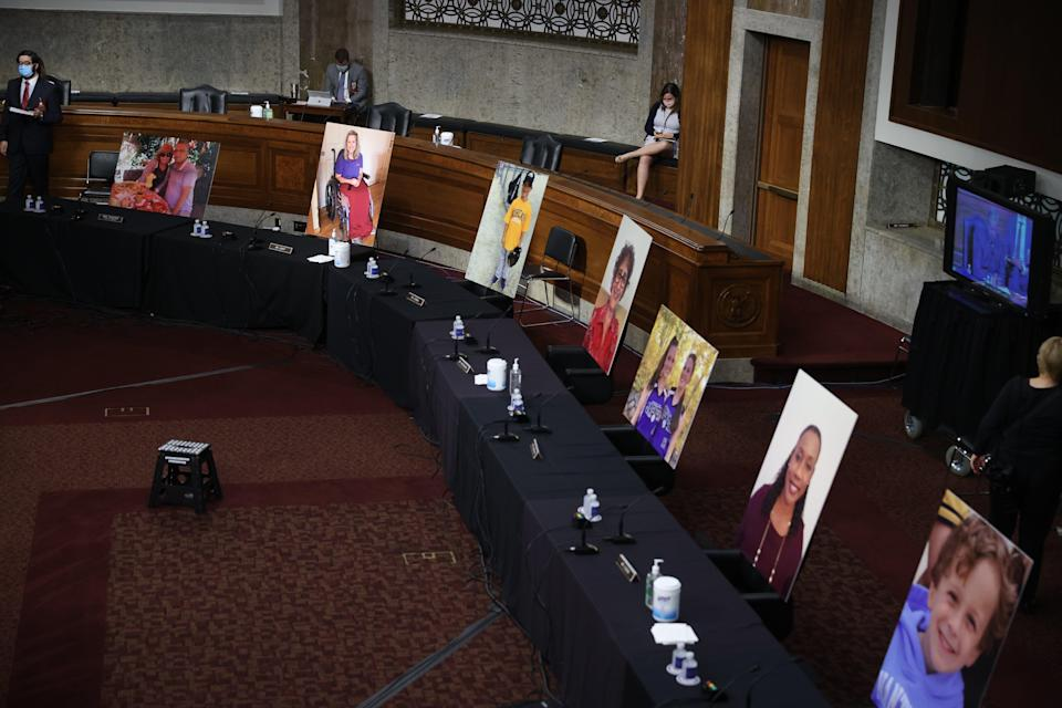 Images of people who've been helped by the Affordable Care Act occupy the seats of Democratic senators boycotting a Senate Judiciary Committee meeting on the nomination of Judge Amy Coney Barrett to be an associate justice of the US Supreme Court on 22 October. (EPA)