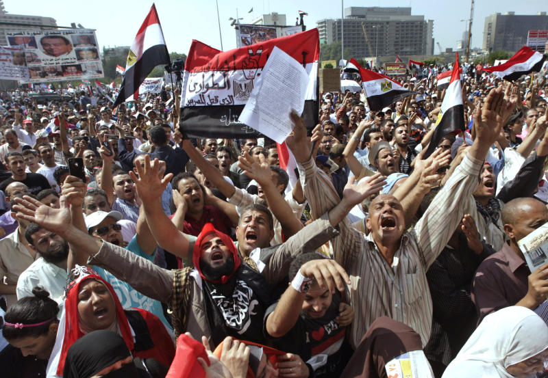 "FILE - In this Friday, Sept. 30, 2011 file photo, thousands of protesters chant slogans against the country's military rulers decision to retain the much hated emergency laws used throughout the reign of ousted President Hosni Mubarak at Tahrir Square, the focal point of Egyptian uprising, in Cairo, Egypt. Under Mubarak, there were no mass killings along the lines of South African or some Latin American dictatorships in the 1980s. But tens of thousands of political prisoners were detained under emergency laws that expired last week after 31 years in force. Torture was systematic, and often extreme, and corruption was completely endemic. Arabic on the banner, center reads, ""no to emergency law."" (AP Photo/Amr Nabil, File)"