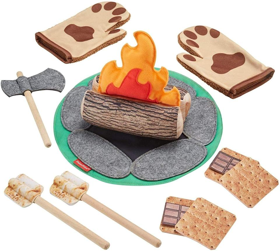 """Trade all the danger of wood-chopping, roaring-fires and grizzly bear attacks for kid-friendly wood accents and soft fabric. Plus no marshmallow and chocolate stains!<br /><br /><strong>Promising review:</strong>""""My daughter is almost 4 and has recently gotten into building tents and forts out of pillows. We used my phone to 'make a fire' but I wanted to get her something cute she could play with instead of my phone. This fits the bill and is affordable. It's cool that you can cut the firewood with the felt ax.<strong>The marshmallows are double-sided, one side is uncooked and the other is cooked. It's also nice that the mat for the fire can double as a picnic pad too.</strong>The material seems very durable as well. The box that this comes in is cute and doubles for storage as well."""" --<a href=""""https://www.amazon.com/dp/B07MT7K36N?tag=huffpost-bfsyndication-20&ascsubtag=5764152%2C24%2C40%2Cd%2C0%2C0%2C0%2C962%3A1%3B901%3A2%3B900%3A2%3B974%3A3%3B975%3A2%3B982%3A2%2C15993493%2C0"""" target=""""_blank"""" rel=""""noopener noreferrer"""">Christie</a><br /><br /><strong>Get it from Amazon for <a href=""""https://www.amazon.com/dp/B07MT7K36N?tag=huffpost-bfsyndication-20&ascsubtag=5764152%2C24%2C40%2Cd%2C0%2C0%2C0%2C962%3A1%3B901%3A2%3B900%3A2%3B974%3A3%3B975%3A2%3B982%3A2%2C15993493%2C0"""" target=""""_blank"""" rel=""""noopener noreferrer"""">$24</a>.</strong>"""