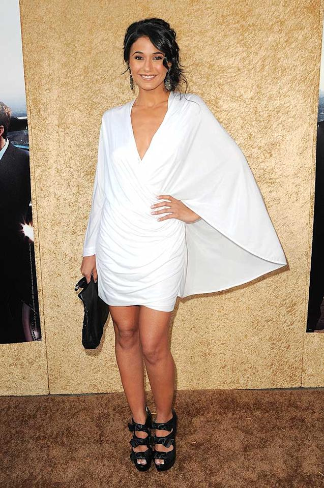 """Actress Emmanuelle Chriqui, who stars as Sloan on """"Entourage,"""" arrived at the show's Season 7 premiere in a plunging white Yigal Azrouel mini (which featured cape-like sleeves) and Christian Louboutin """"Madame Butterfly"""" booties. Jordan Strauss/<a href=""""http://www.wireimage.com"""" target=""""new"""">WireImage.com</a> - June 16, 2010"""