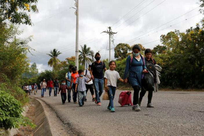 Hondurans take part in a new caravan of migrants set to head to the United States