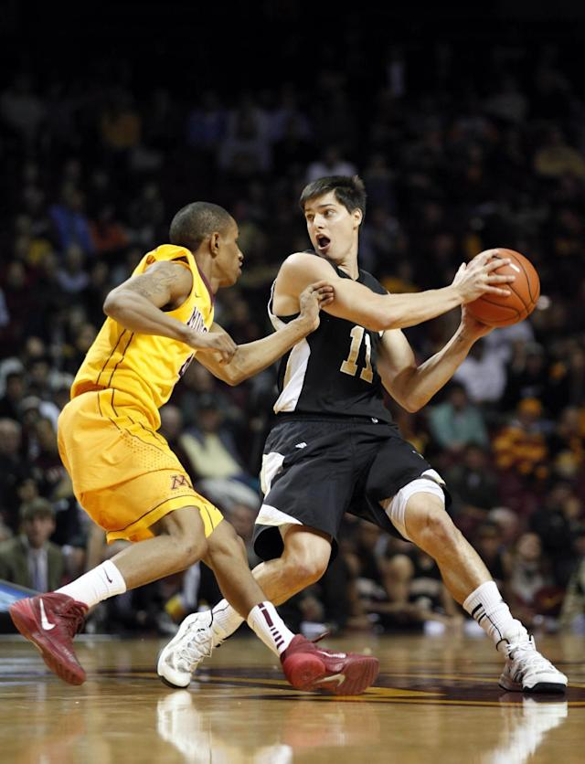 Wofford guard Indiana Faithfull (11) protects the ball from Minnesota guard DeAndre Mathieu in the first half of an NCAA college basketball game Thursday, Nov. 21, 2013, in Minneapolis. (AP Photo/Stacy Bengs)