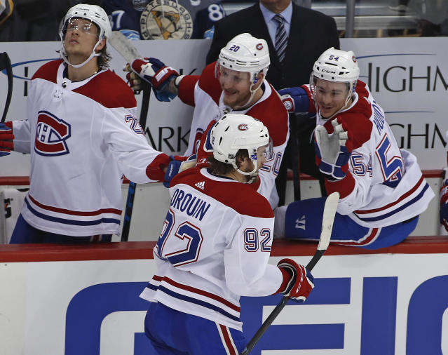 Montreal Canadiens' Jonathan Drouin (92) celebrates as he returns to the bench after scoring during the first period of the team's NHL hockey game against the Pittsburgh Penguins in Pittsburgh, Wednesday, March 21, 2018. (AP Photo/Gene J. Puskar)