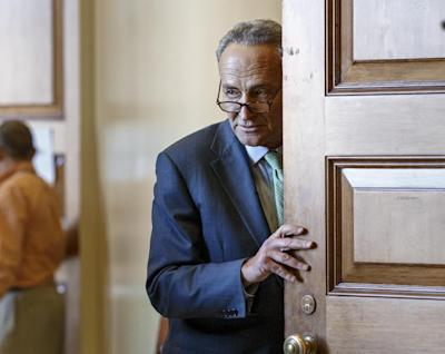 Sen. Chuck Schumer, D-N.Y., emerges from a Democratic caucus meeting at the Capitol in Washington, Tuesday, Nov. 18, 2014. (AP Photo/J. Scott Applewhite)
