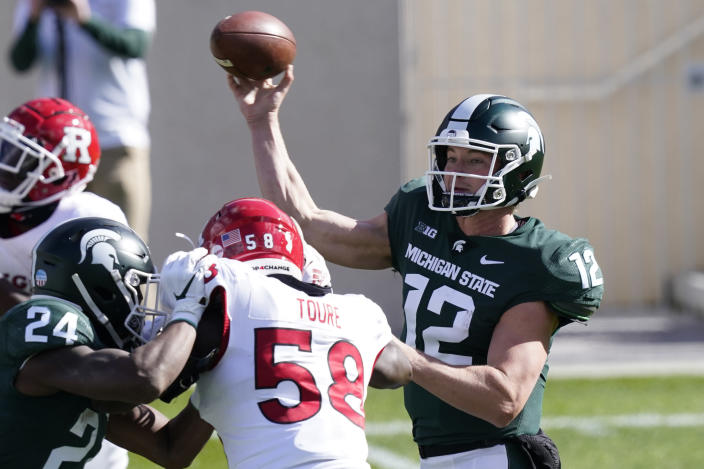 Michigan State quarterback Rocky Lombardi throws during the first half of an NCAA college football game against Rutgers, Saturday, Oct. 24, 2020, in East Lansing, Mich. (AP Photo/Carlos Osorio)