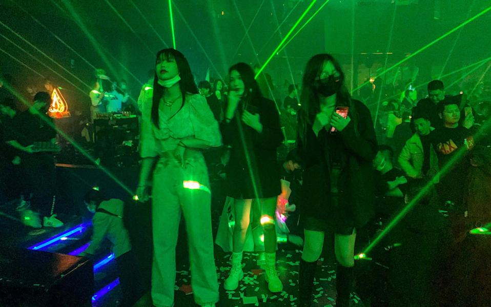 People visit a nightclub in Wuhan on January 21