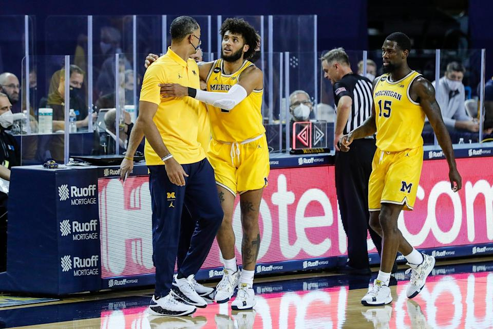 Michigan forward Isaiah Livers (2) pushes away head coach Juwan Howard as the referee calls a technical foul on Howard during the second half against Toledo at Crisler Center in Ann Arbor, Wednesday, Dec. 9, 2020.