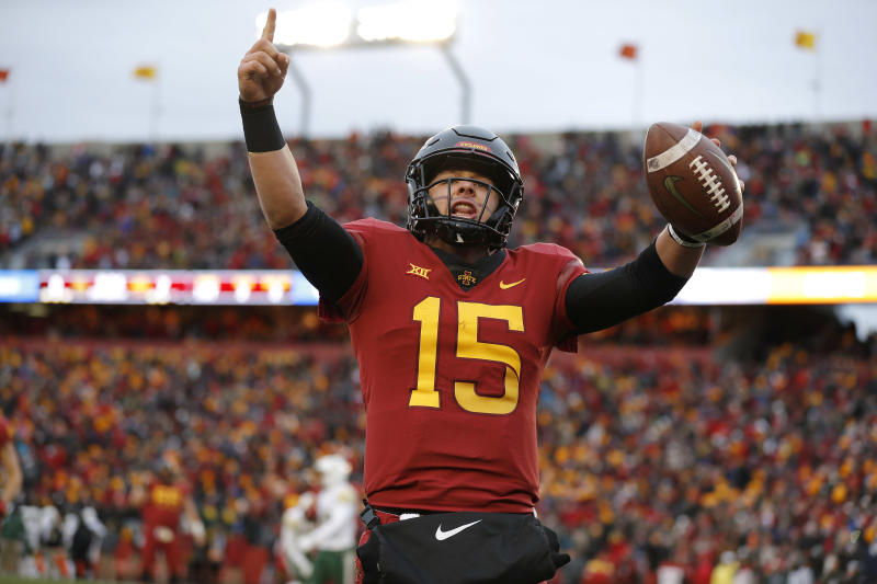 FILE - In this Saturday, Nov. 10, 2018, file photo, Iowa State quarterback Brock Purdy celebrates his touchdown run during the first half of an NCAA college football game against Baylor in Ames. Oklahoma's Kyler Murray, West Virginia's Will Grier, Iowa State's Brock Purdy and Sam Ehlinger of Texas have been impressive and could determine which teams makes it to the Dec. 1 title game in Arlington, Texas. (AP Photo/Matthew Putney, File)