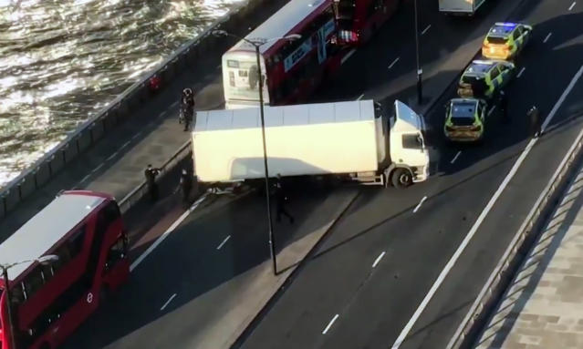 Armed police surround a truck parked across lanes of traffic on London Bridg, following the incident in November. (AP)
