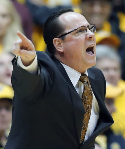 Wichita State's coach Gregg Marshall shouts instructions to his team during an NCAA basketball game, Saturday, Feb. 22, 2014 in Wichita, Kan. (AP Photo/The Wichita Eagle, Travis Heying)