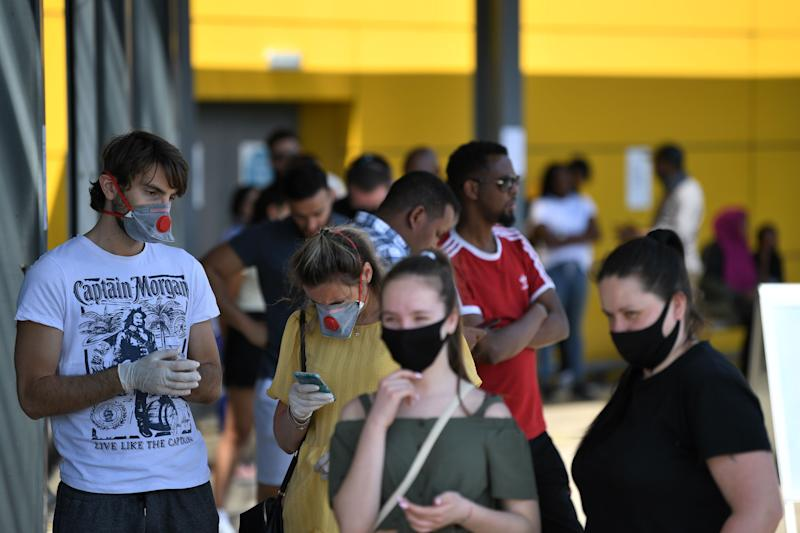 Members of the public wearing protective face masks queue outside an Ikea store at Wembley in north-west London as it re-opens its doors following the easing of the lockdown restrictions during the novel coronavirus COVID-19 pandemic on June 1, 2020. - Some non-essential stores, car dealerships and outdoor markets in Britain on June 1 were able to reopen from their COVID-19 shutdown in an easing of coronavirus lockdown measures. (Photo by DANIEL LEAL-OLIVAS / AFP) (Photo by DANIEL LEAL-OLIVAS/AFP via Getty Images)