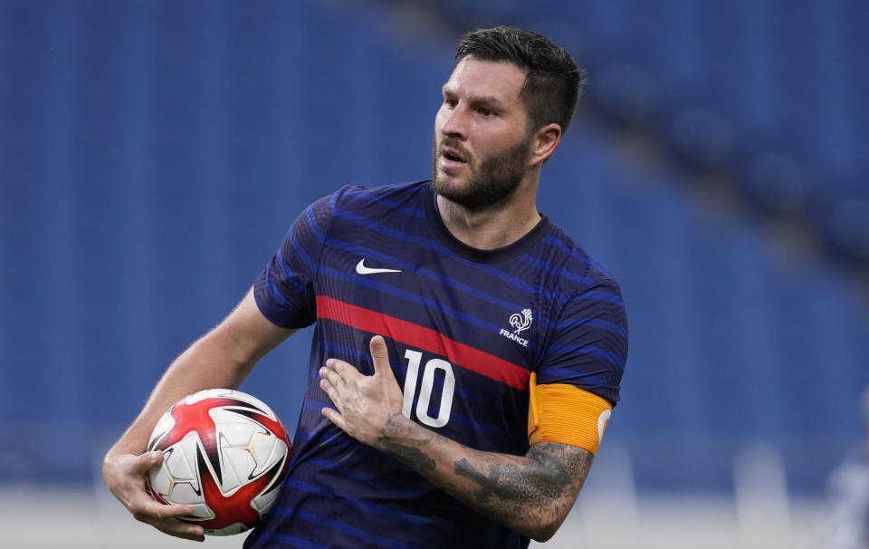 France's Andre-Pierre Gignac celebrates after scoring a goal during a men's soccer match against South Africa at the 2020 Summer Olympics, Sunday, July 25, 2021, in Saitama, Japan. (AP Photo/Martin Mejia)