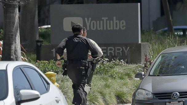 PHOTO: Officers run toward the YouTube offices in San Bruno, Calif., April 3, 2018. (Jeff Chiu/AP)