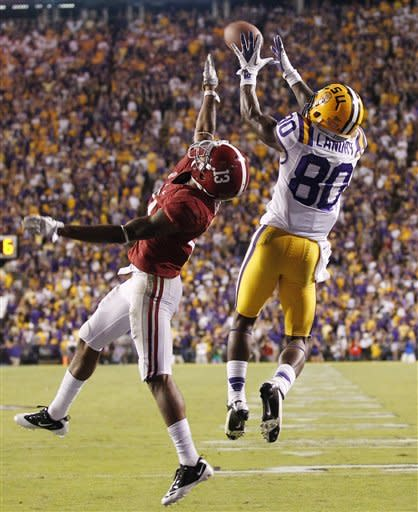 LSU wide receiver Jarvis Landry (80) catches a touchdown pass over Alabama defensive back Deion Belue (13) during the fourth quarter of an NCAA college football game in in Baton Rouge, La., Saturday, Nov. 3, 2012. (AP Photo/Bill Haber)