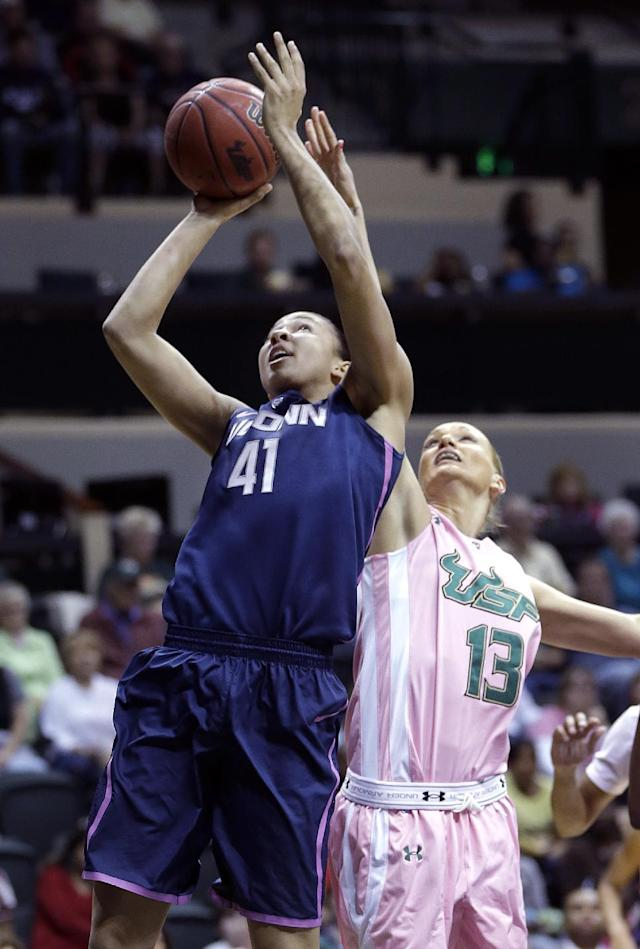 Connecticut center Kiah Stokes (41) shoots over South Florida guard Inga Orekhova (13) during the first half of an NCAA women's college basketball game, Sunday, Feb. 16, 2014, in Tampa, Fla. (AP Photo/Chris O'Meara)