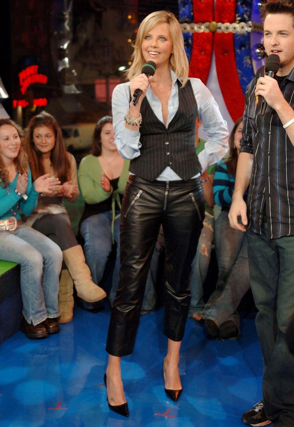 <p>Nothing ruined an outfit in the 2000s quite like a vest. First example, Charlize Theron on <em>TRL </em>in 2005. </p>