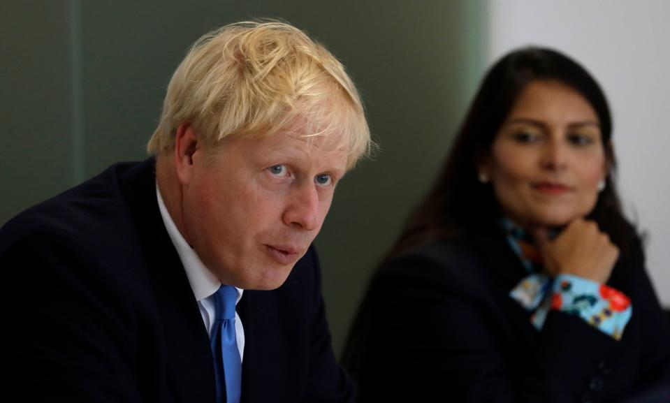 Britain's Prime Minister Boris Johnson (L), accompanied by Britain's Home Secretary Priti Patel, speaks at the first meeting of the National Policing Board at the Home Office in London, on July 31, 2019. (Photo by Kirsty Wigglesworth / POOL / AFP) (Photo credit should read KIRSTY WIGGLESWORTH/AFP via Getty Images)