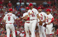 St. Louis Cardinals manager Mike Shildt, left, takes the ball from starting pitcher Adam Wainwright as Wainwright leaves the baseball game during the sixth inning against the Miami Marlins, Thursday, June 20, 2019, in St. Louis. (AP Photo/L.G. Patterson)