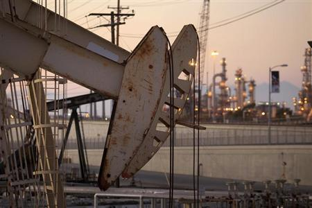 Oil rig pumpjacks, also known as thirsty birds, extract crude from the Wilmington Field oil deposits area where Tidelands Oil Production Company, which is owned by Occidental Petroleum Corporation (Oxy), operates near Long Beach, California July 30, 2013.