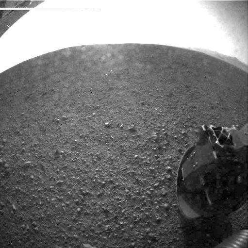 """This is one of the first images taken by NASA's Curiosity rover, which landed on Mars the evening of Aug. 5 PDT (morning of Aug. 6 EDT). It was taken through a """"fisheye"""" wide-angle lens on the left Hazard-Avoidance camera on the left-rear side"""