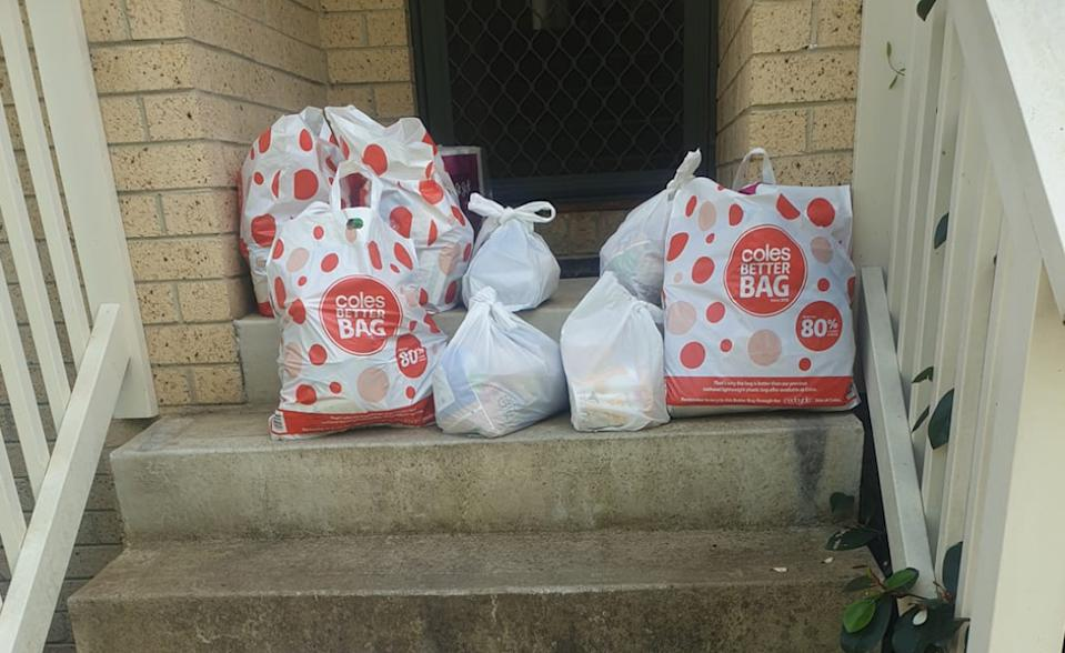 Groceries on a home's front steps after a family had their Coles order taken away.