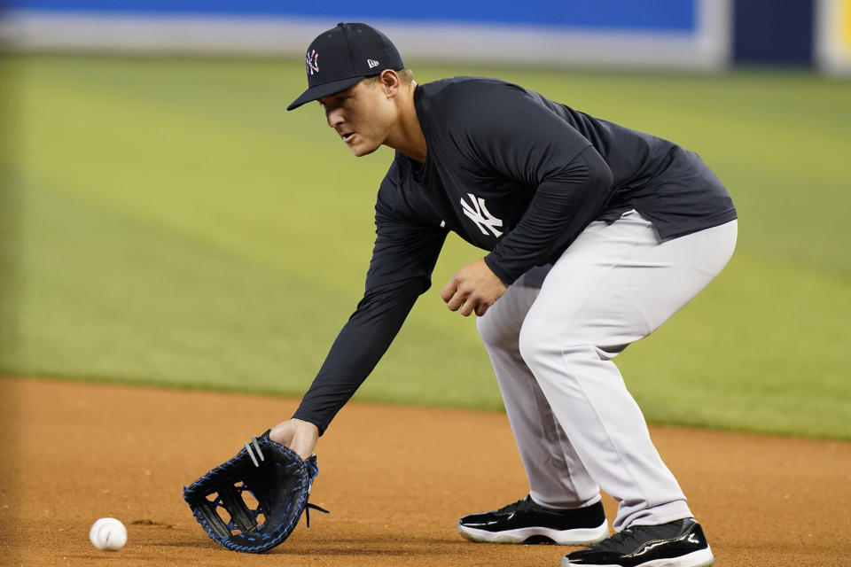 New York Yankees first baseman Anthony Rizzo fields a ball before the team's baseball game against the Miami Marlins, Friday, July 30, 2021, in Miami. Rizzo was acquired in a trade from the Chicago Cubs. (AP Photo/Lynne Sladky)