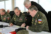 Russian Defence Minister Sergei Shoigu (C) and Chief of the Russian General Staff Valery Gerasimov (R) oversee military drills the east of Crimea