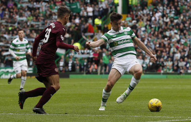 """Britain Football Soccer - Celtic v Heart of Midlothian - Scottish Premiership - Celtic Park - 21/5/17 Celtic's Kieran Tierney in action with Hearts' Jamie Brandon Reuters / Russell Cheyne Livepic EDITORIAL USE ONLY. No use with unauthorized audio, video, data, fixture lists, club/league logos or """"live"""" services. Online in-match use limited to 45 images, no video emulation. No use in betting, games or single club/league/player publications. Please contact your account representative for further details."""