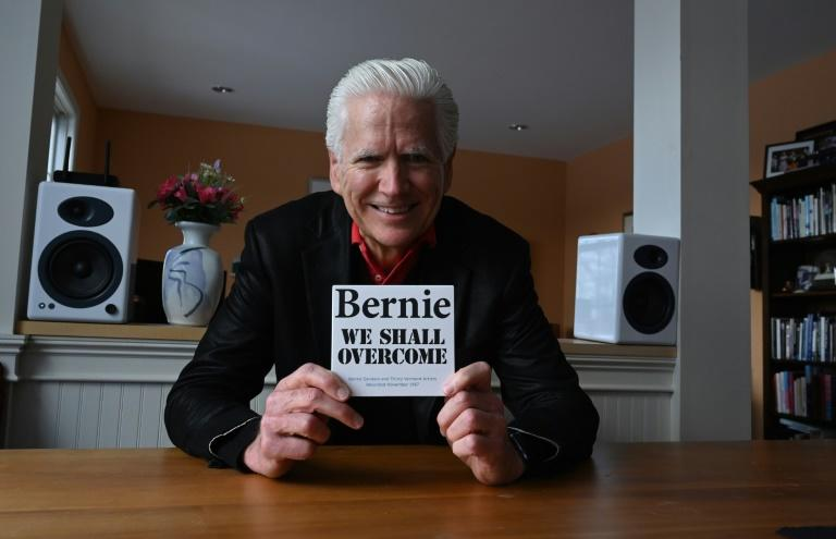 Todd Lockwood, at his Burlington, Vermont home with a copy of the folk album that he produced, which featured then-mayor Bernie Sanders