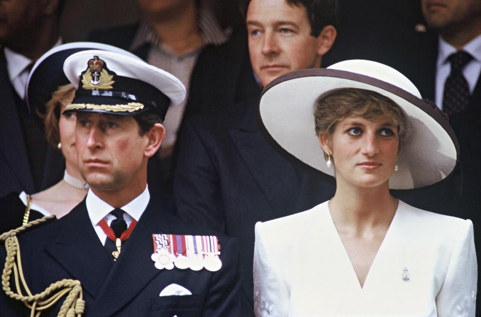 LONDON, ENGLAND - JUNE 21: Prince Charles, Prince of Wales and Diana, Princess of Wales, wearing a white embroidered dress designed by Catherine Walker, a white hat designed by Marina Killery and a diamond Regimental brooch, attend the Gulf War Victory Parade at Mansion House on June 21, 1991 in London, United Kingdom. (Photo by Anwar Hussein/Getty Images)