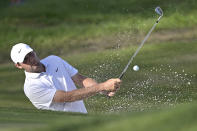 Scottie Scheffler hits out of a bunker onto the 17th green during the third round of the Workday Championship golf tournament Saturday, Feb. 27, 2021, in Bradenton, Fla. (AP Photo/Phelan M. Ebenhack)