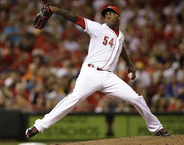 Cincinnati Reds relief pitcher Aroldis Chapman throws against the St. Louis Cardinals in the ninth inning of a baseball game, Friday, May 23, 2014, in Cincinnati. Chapman picked up his fourth save as the Reds won 5-3. (AP Photo/Al Behrman)